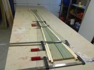 The stiffeners are glued to the longerons and curing