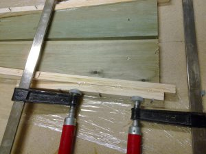 Aft stiffener are glued on the outside of the longeron