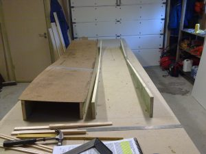 The jigs are erected and bondoed in place directly on the working table